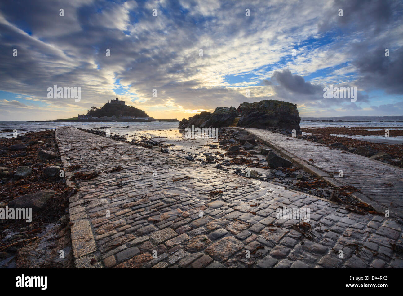 St Michael's Mount in Cornwall captured at sunset from the causeway - Stock Image