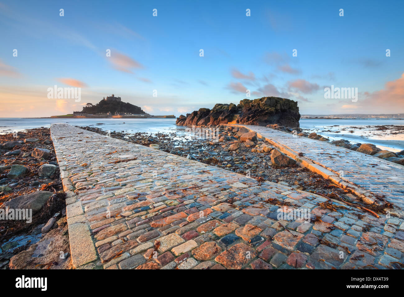 St Michael's Mount in Cornwall captured at sunrise from the causeway - Stock Image
