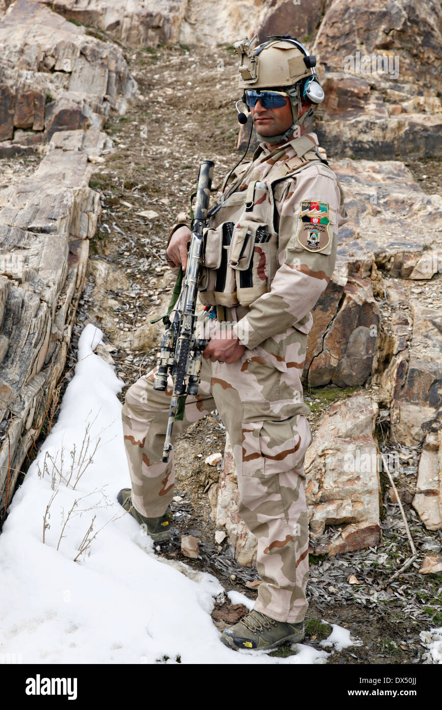 An Afghan solider with Task Unit Wardak during an armed reconnaissance operation March 6, 2014 in Zabodaq village, Wardak province, Afghanistan. - Stock Image