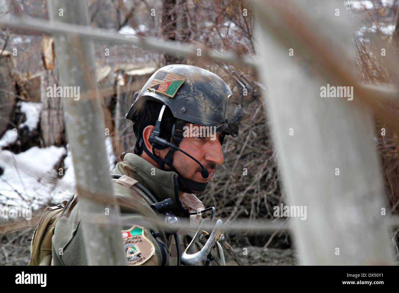 An Afghan patrolman with Task Unit Wardak during an armed reconnaissance operation March 6, 2014 in Zabodaq village, Wardak province, Afghanistan. - Stock Image