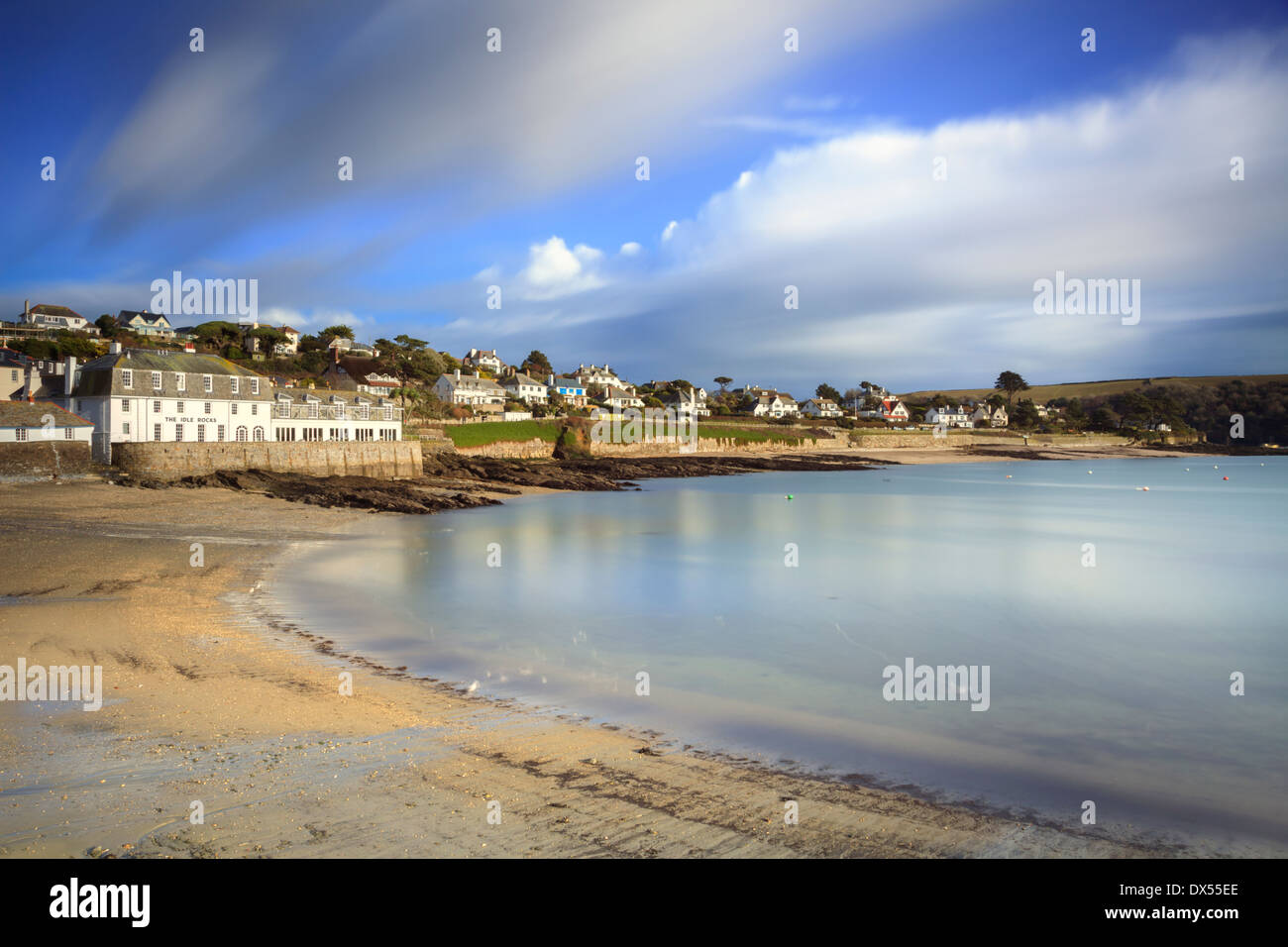 St Mawes in Cornwall captured using a long exposure to blur the movement in the water and clouds - Stock Image