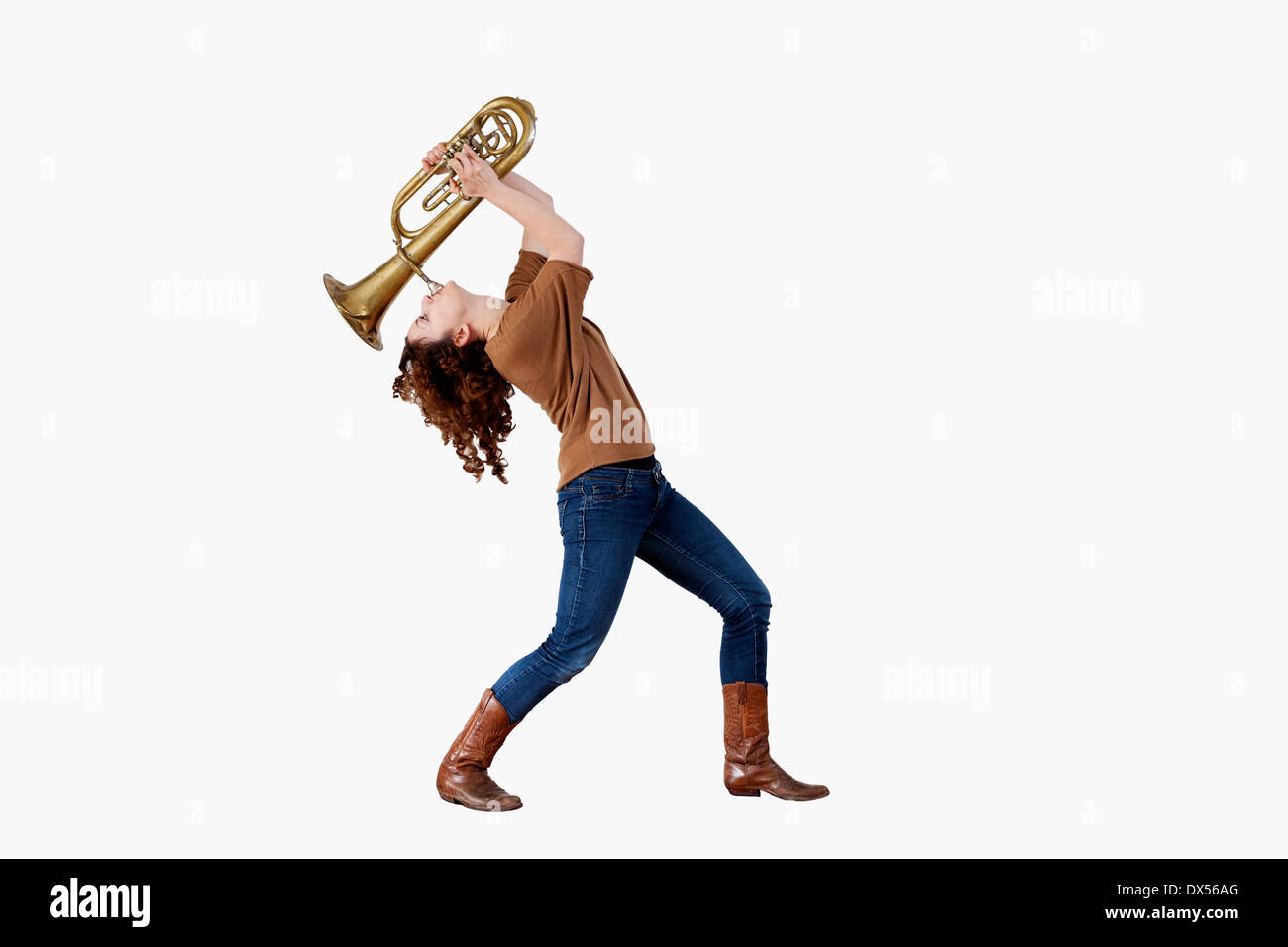 Young Woman playing the trumpet - Stock Image