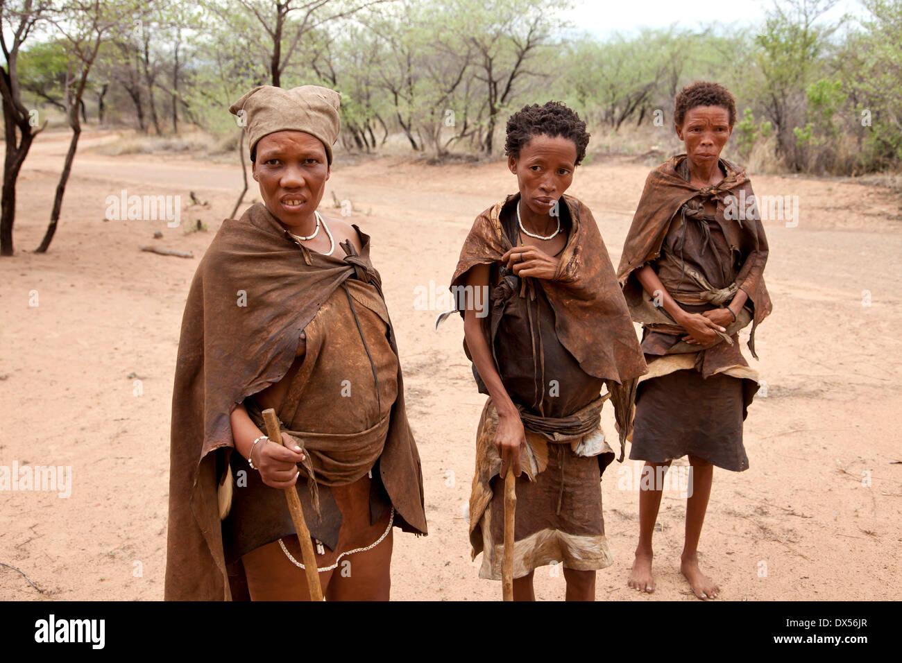 San or Bushmen women in traditional dress, Ghanzi, Botswana - Stock Image