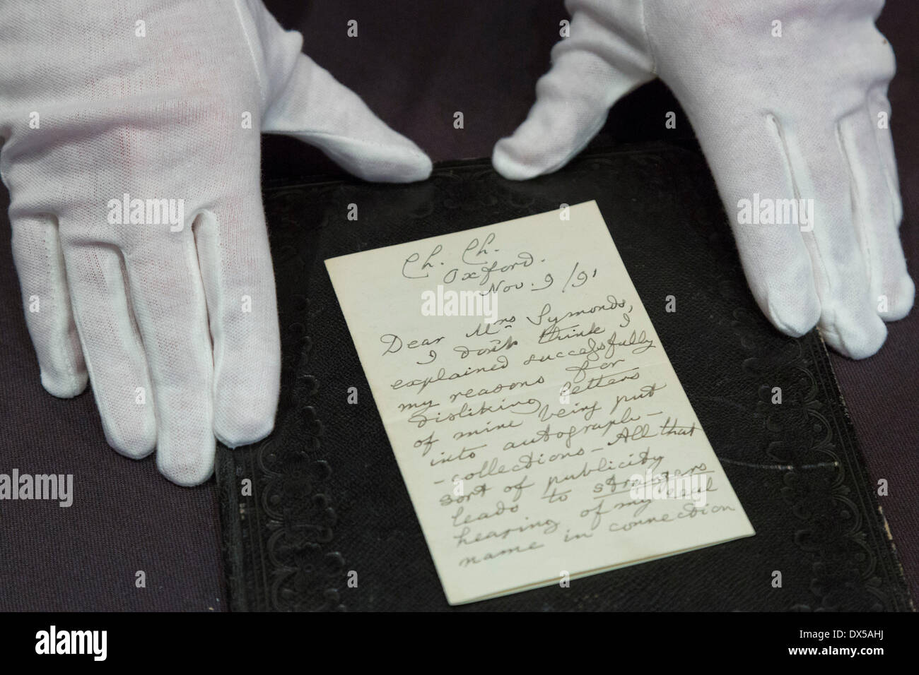 London, UK, 18 March 2014. The letter from Alice in Wonderland author Lewis Carroll (under his real name Charles Dodgson) to a friend complaining about the drawbacks of fame goes under the hammer and is expected to fetch £3,000-£4,000. In the letter, Carroll says he hated publicity so intensely that 'sometimes I almost wish I had never written any books at all'. The Bonhams' Books, Maps, Manuscripts and Historical Photographs auction takes place on 19 March 2014. Credit:  Nick Savage/Alamy Live News - Stock Image