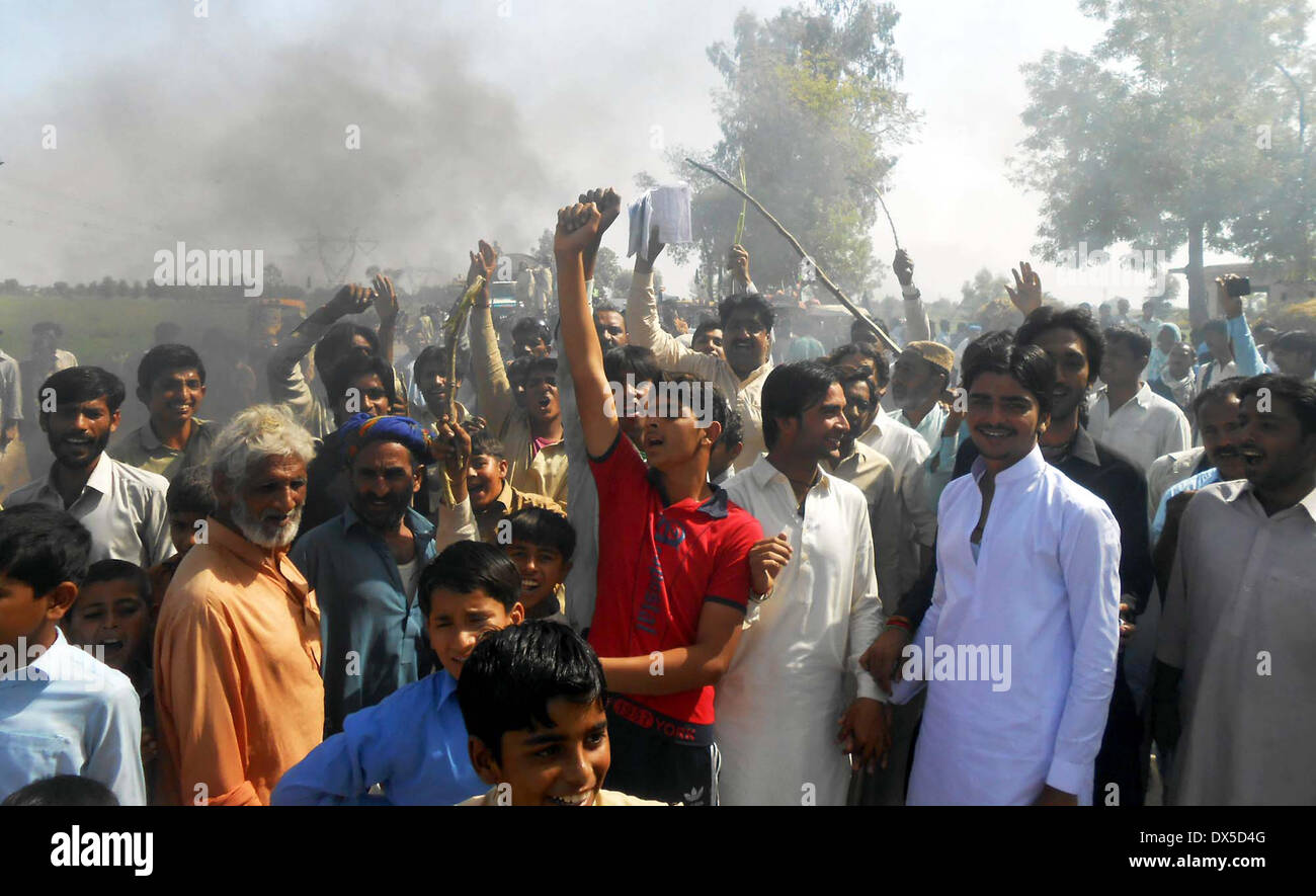 Residents of Village Wandh Ali Muhammad Kertio are protesting against disconnection of electricity supply to their village as they blocked the road by burning bushes while demonstration, on Tuesday, March 18, 2014. - Stock Image