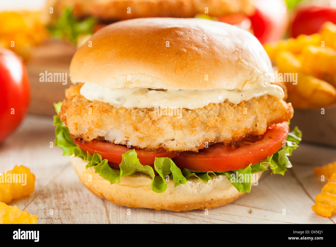 Breaded Fish Sandwich with Tartar Sauce and Fries - Stock Image