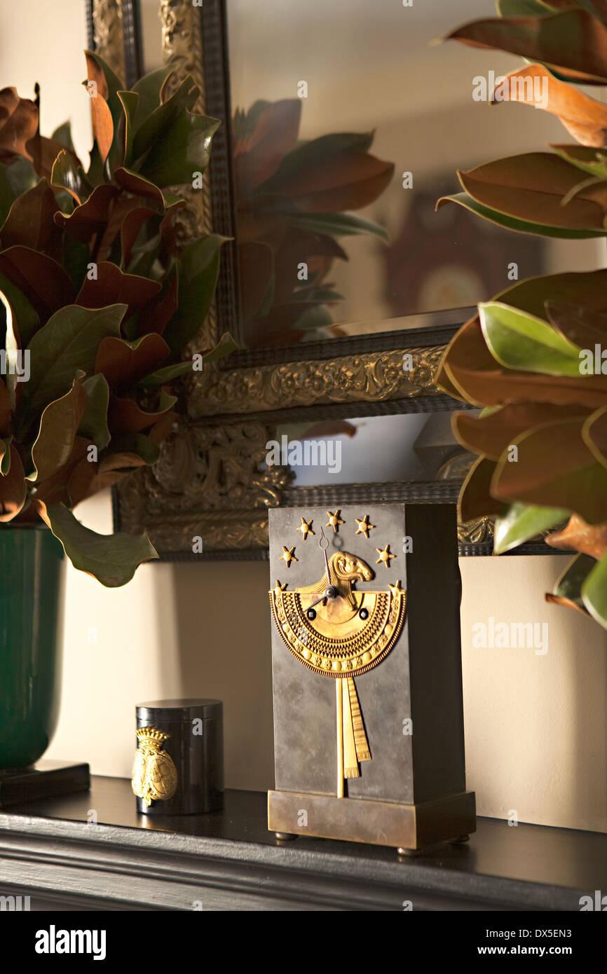 Ornate clock on mantel in living room - Stock Image