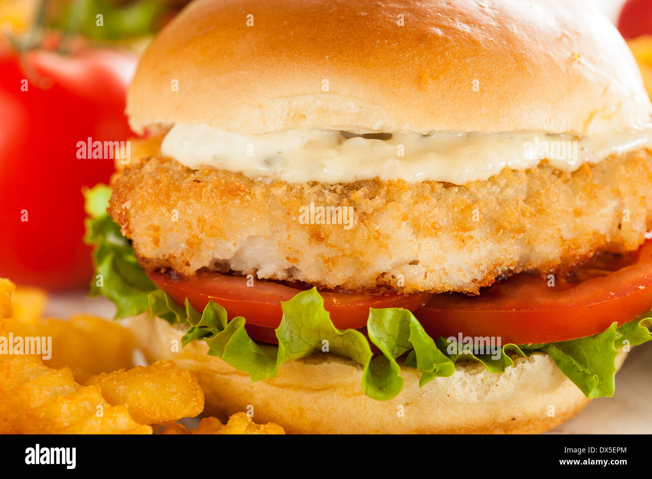 Breaded Fish Sandwich with Tartar Sauce and Fries Stock Photo