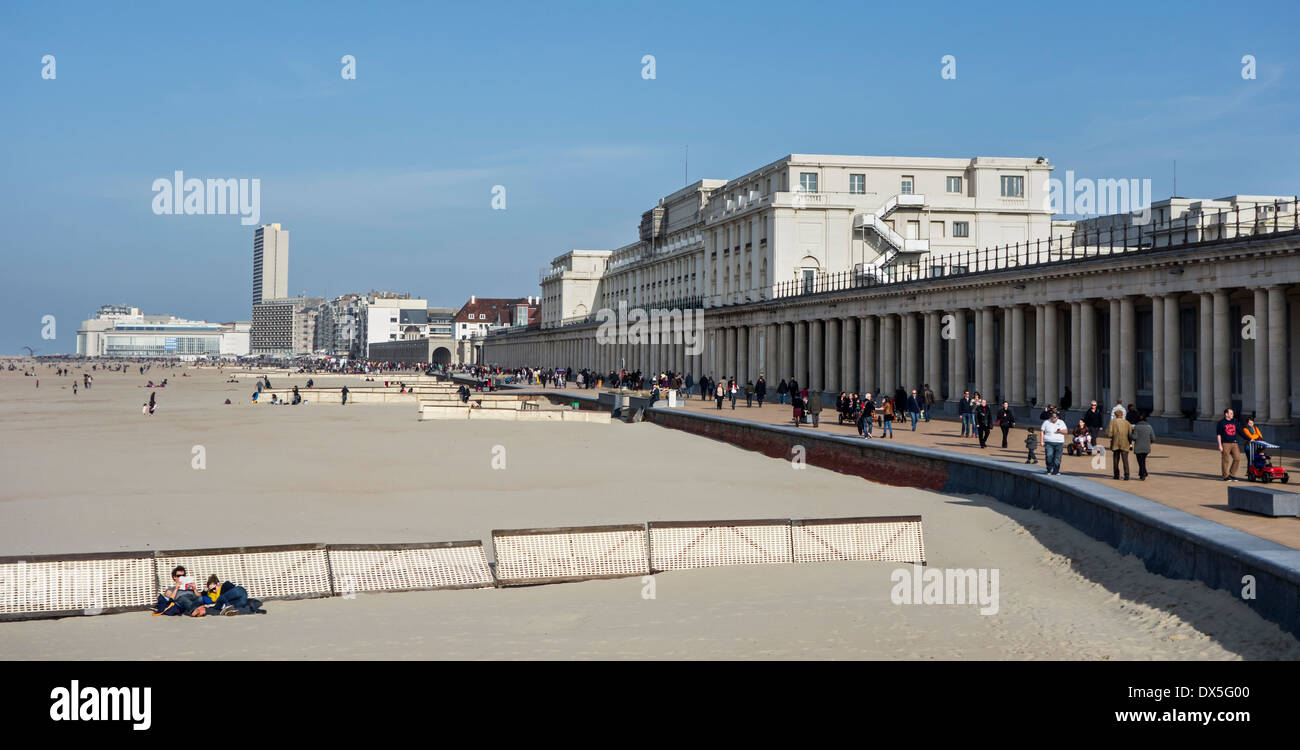 Beach, the Royal Galleries / Koninklijke Gaanderijen and the Thermae Palace Hotel, neoclassical arcade at Ostend, Belgium - Stock Image