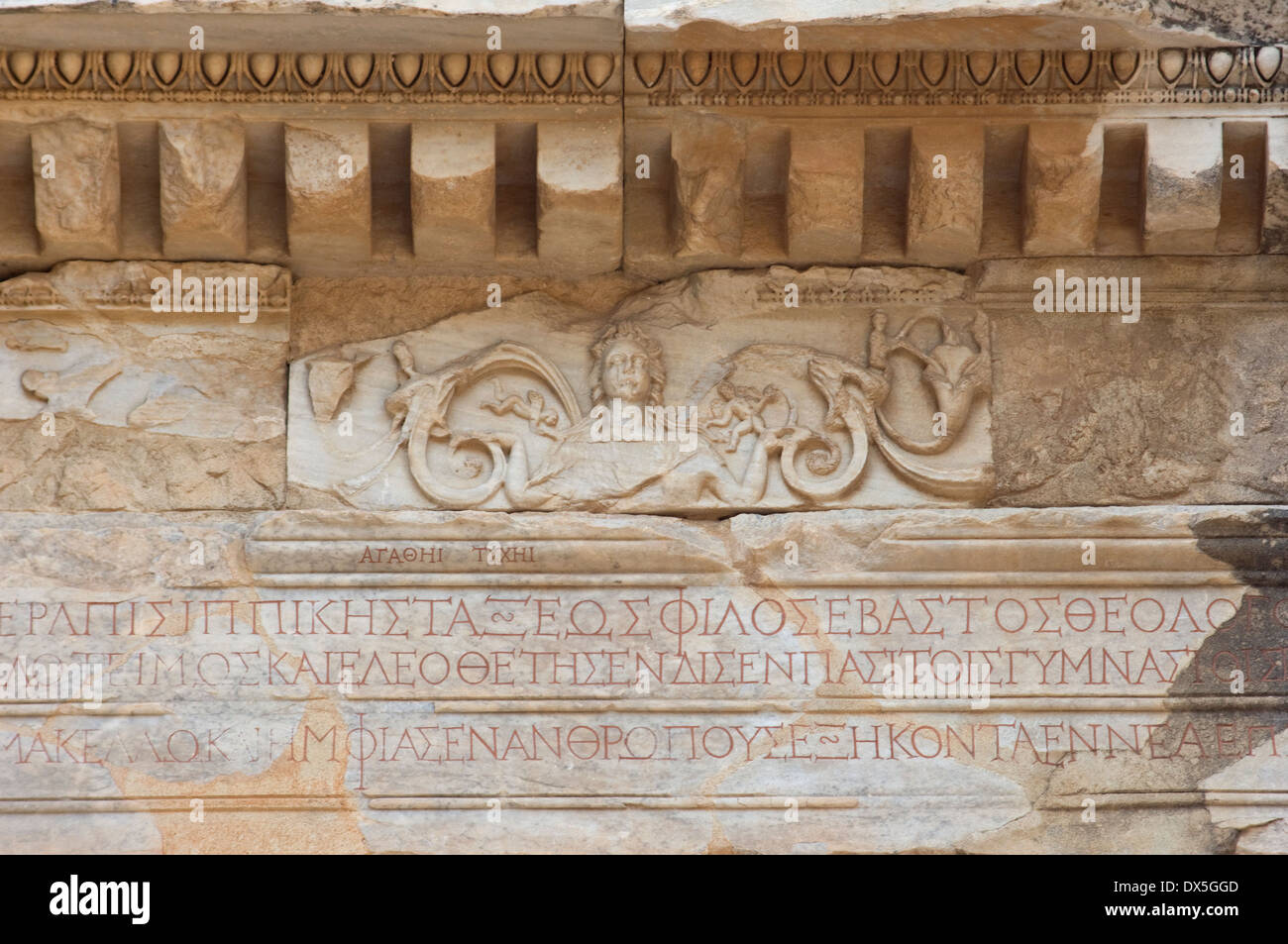 Medusa bas-relief and ancient Greek inscriptions on the gate to the agora at Ephesus, Turkey. Digital photograph - Stock Image