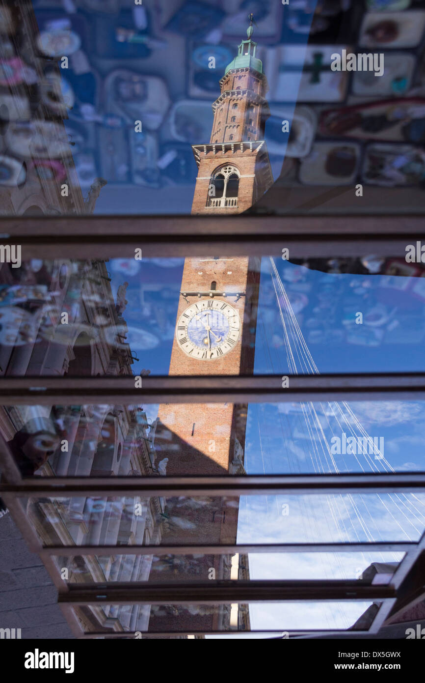 Bissara's Tower reflection on a market stall in Piazza dei Signori, Vicenza, Italy - Stock Image