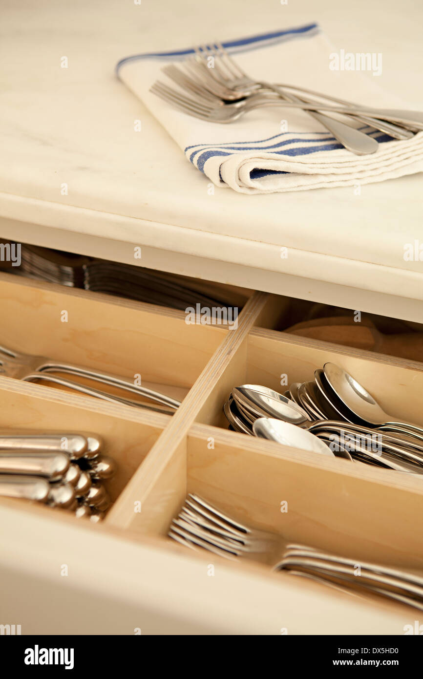 Silverware in organized drawer in domestic kitchen, high angle view - Stock Image