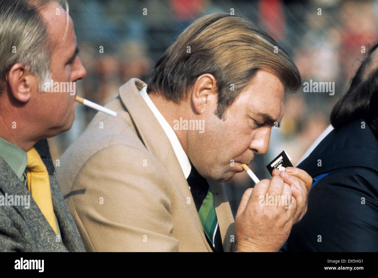 football, Bundesliga, 1975/1976, Grotenburg Stadium, FC Bayer 05 Uerdingen versus FC Schalke 04 3:2, president Guenther Siebert (S04) on the coaching bench, lighting a cigarette - Stock Image