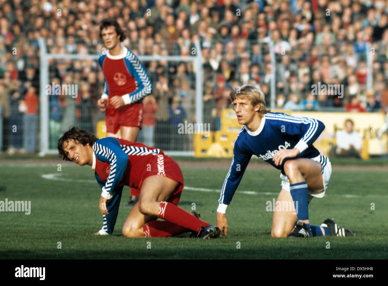 football, Bundesliga, 1975/1976, Grotenburg Stadium, FC Bayer 05 Uerdingen versus FC Schalke 04 3:2, scene of the match, Hans-Juergen Wloka (Uerdingen) left and Klaus Fichtel (S04) looking after the ball - Stock Image