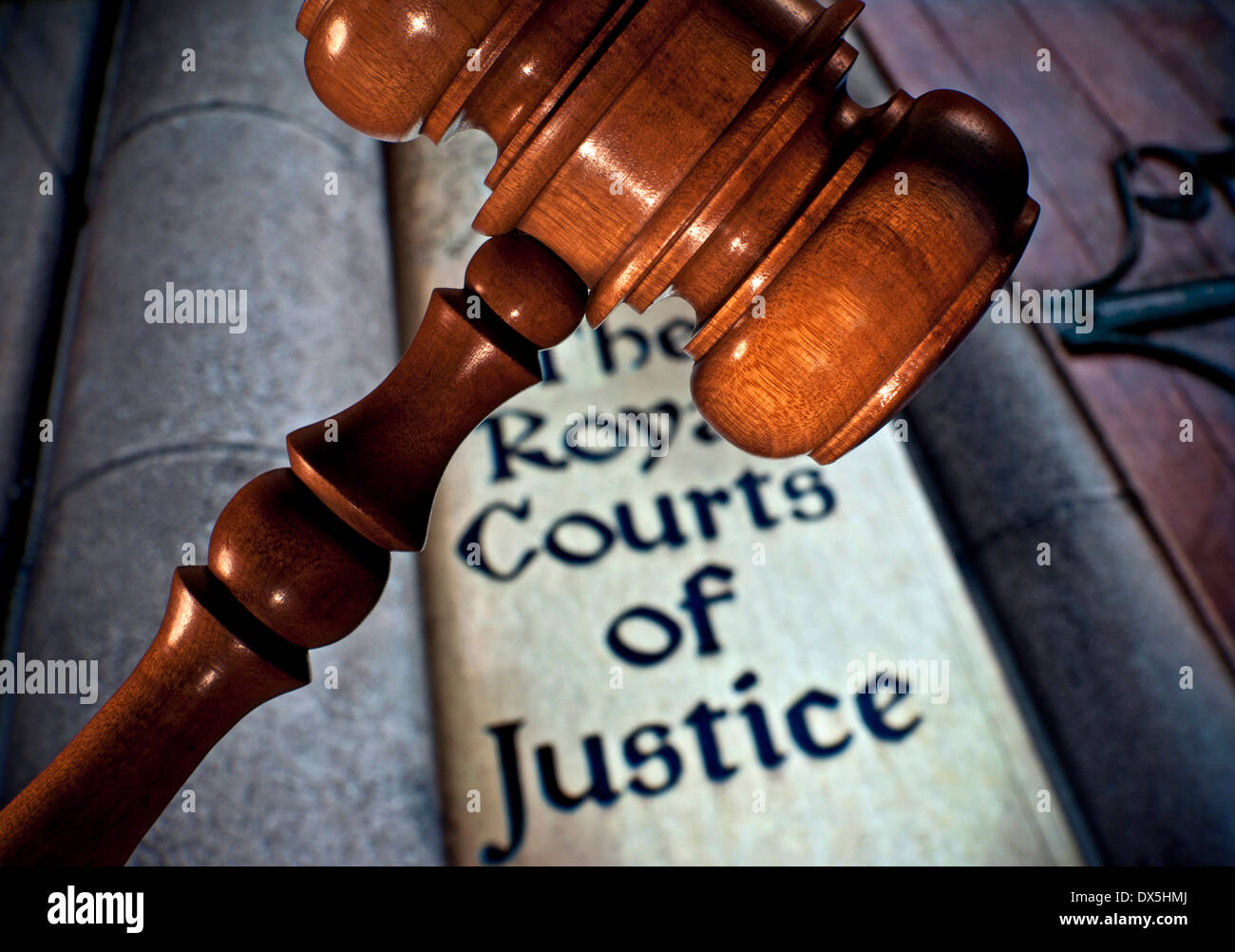 Law / Justice concept Close view on Judges gavel with entrance sign to Royal Courts of Justice Holborn London UK - Stock Image
