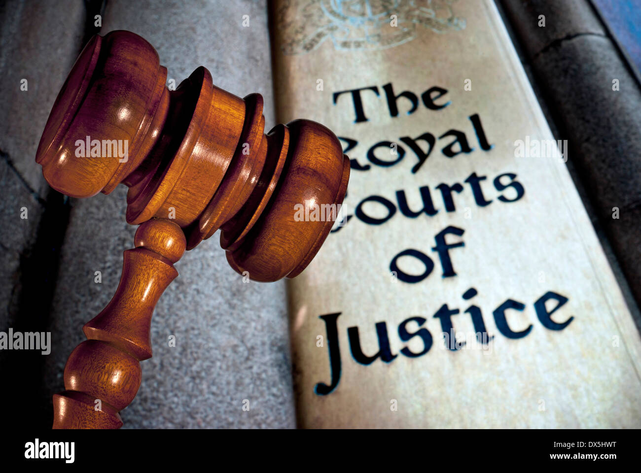 Law / Justice concept Close view on Judges gavel with entrance sign to Royal Courts of Justice London UK - Stock Image