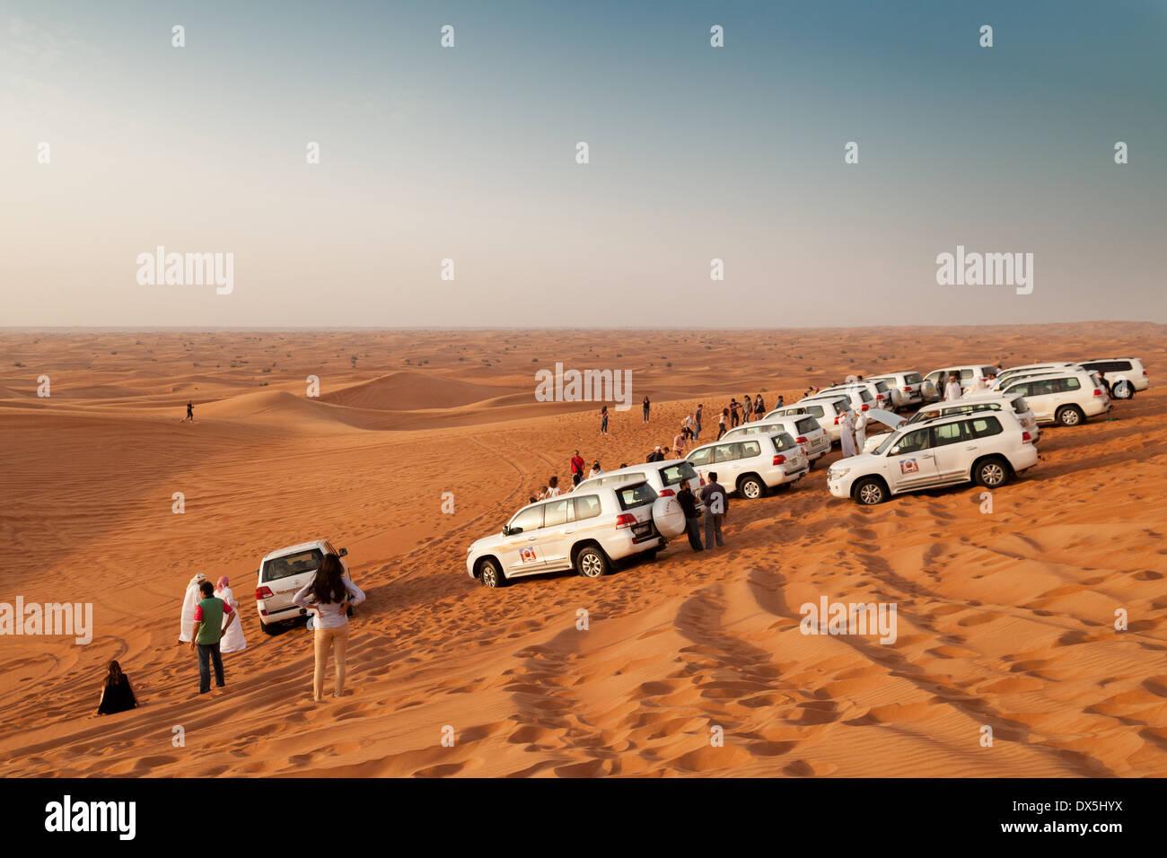 Group of 4 wheel drive cars on a desert safari tour, Dubai, Arabian desert, UAE, United Arab Emirates, Middle East - Stock Image