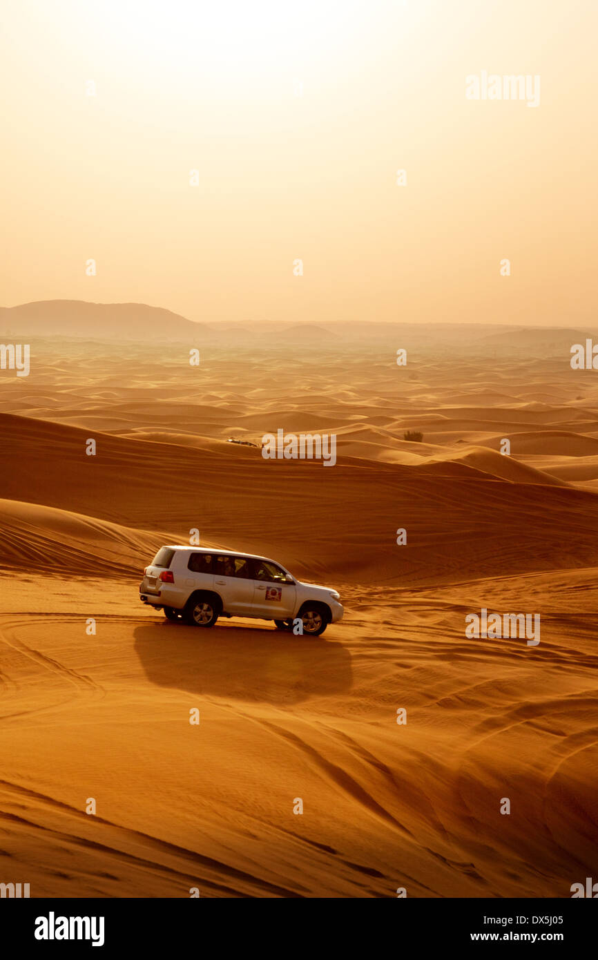 A 4 wheel drive jeep in the Arabian desert, Dubai desert safari, Dubai, UAE, United Arab Emirates, Middle East - Stock Image