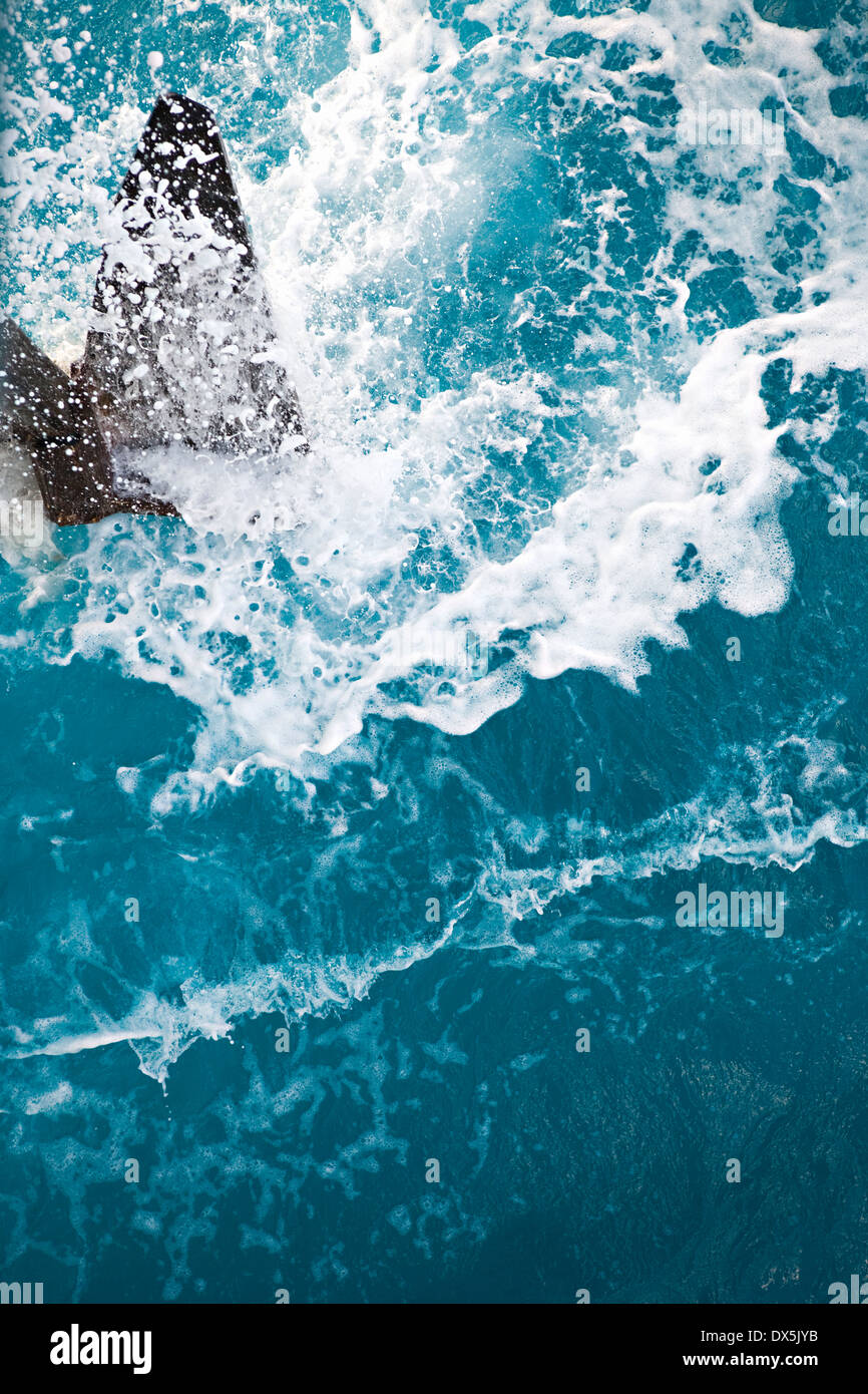 Ocean splash from anchor raising, directly above - Stock Image