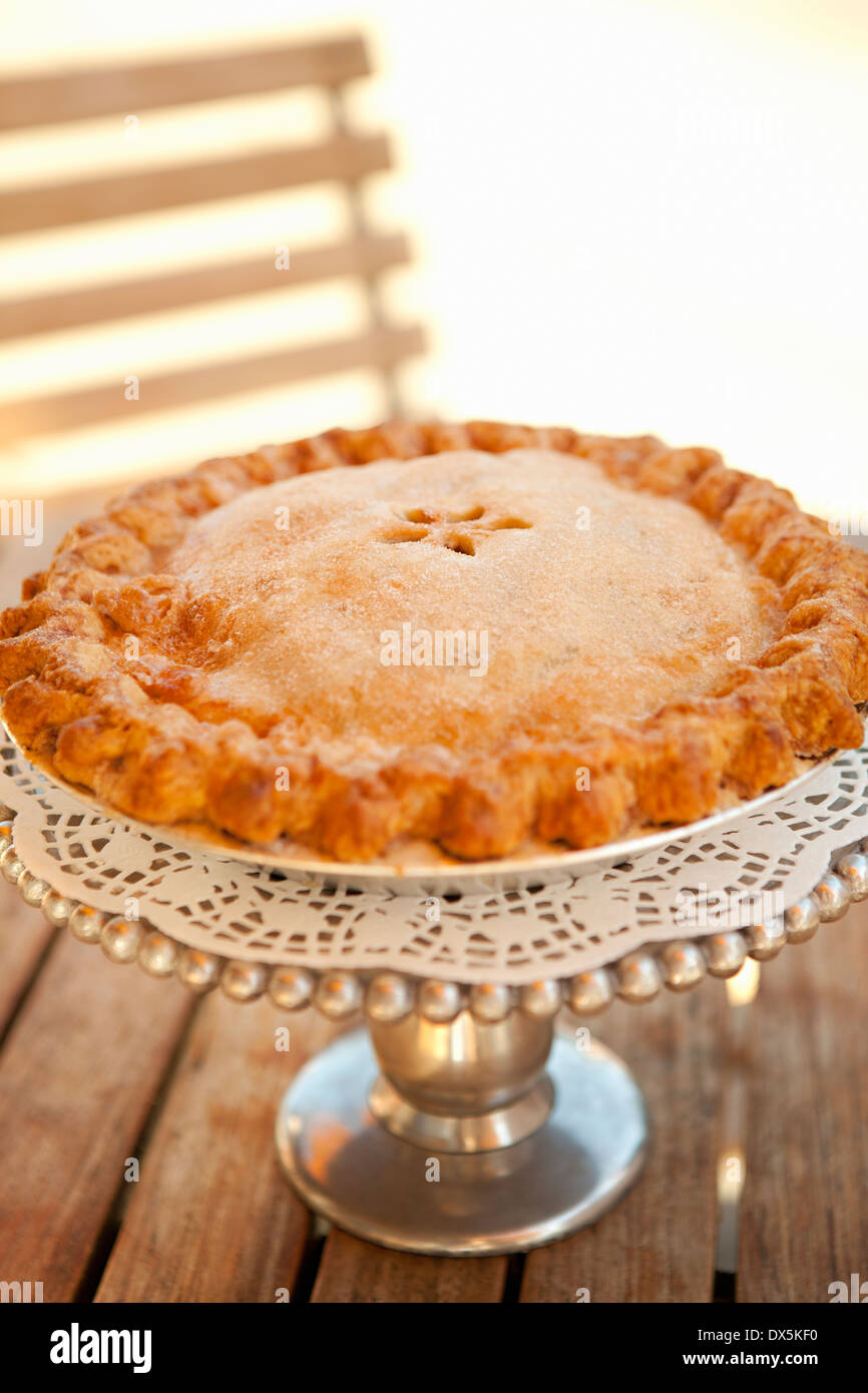 Homemade whole pie on cake stand, close up - Stock Image