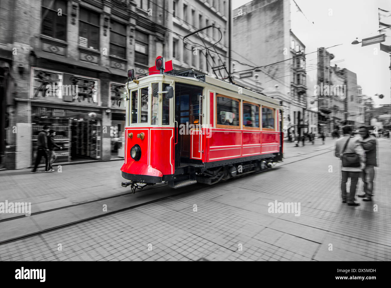 Trams passing through Istiklal street. Selective focus. Slow time shutter speed for the panning effect - Stock Image