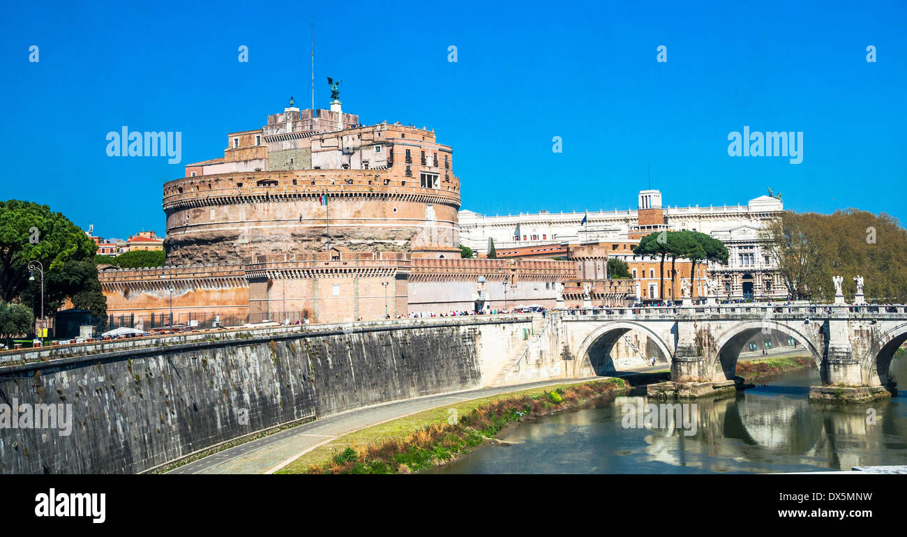 Castel Sant'angelo and Bernini's statue on the bridge, Rome, Italy. Palace of justice, (palazzaccio) on the background - Stock Image