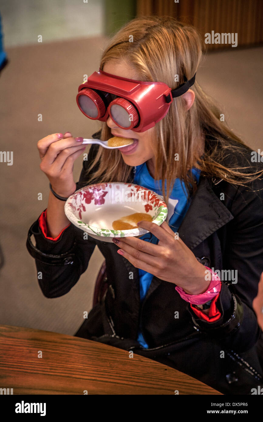 A visitor to a school for the blind in Tustin, CA, is blindfolded to allow her to experience sightlessness as well Stock Photo