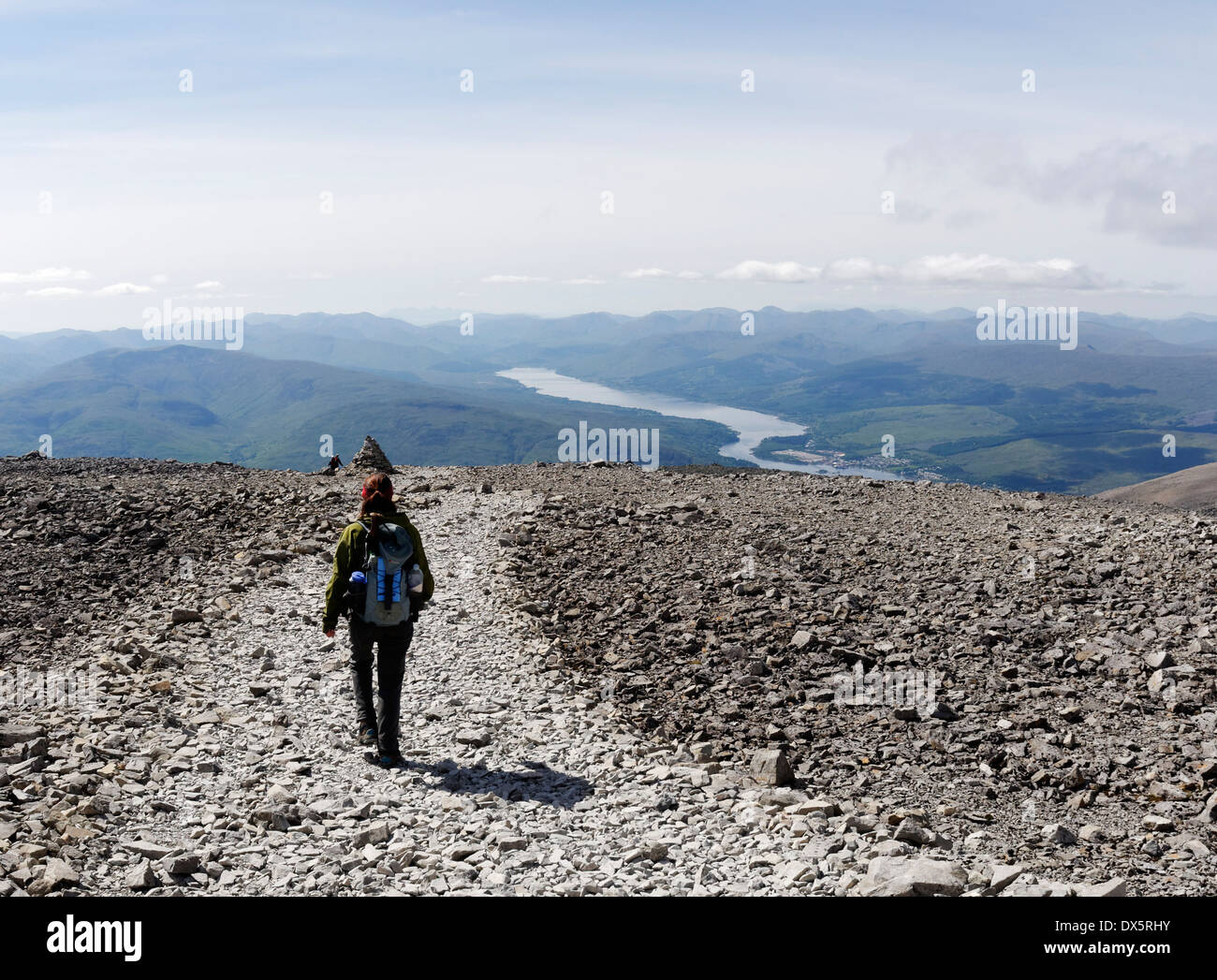 A lady hillwalker leaving the summit of Ben Nevis in Scotland - Stock Image