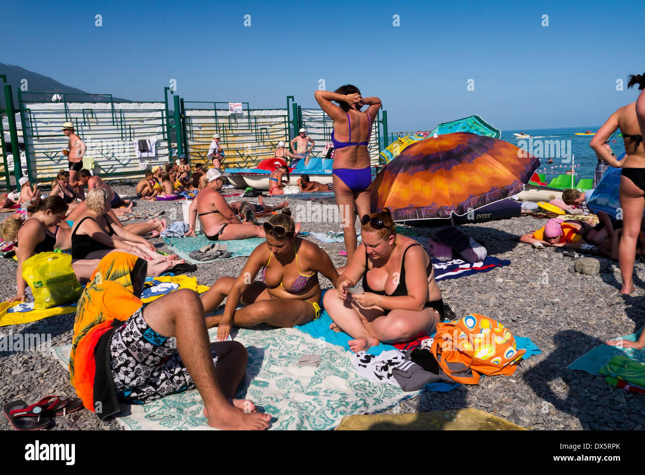 People tanning on the beach in Yalta, Ukraine Stock Photo ...