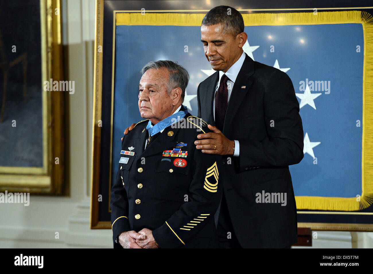 US President Barack Obama awards the Medal of Honor to Master Sgt. Jose Rodela during a ceremony at the White House March 18, 2014 in Washington D.C. Rodela earned the Medal of Honor for his valorous actions during combat operations against an armed enemy in Phuoc Long Province, Republic of Vietnam on September 1, 1969. - Stock Image