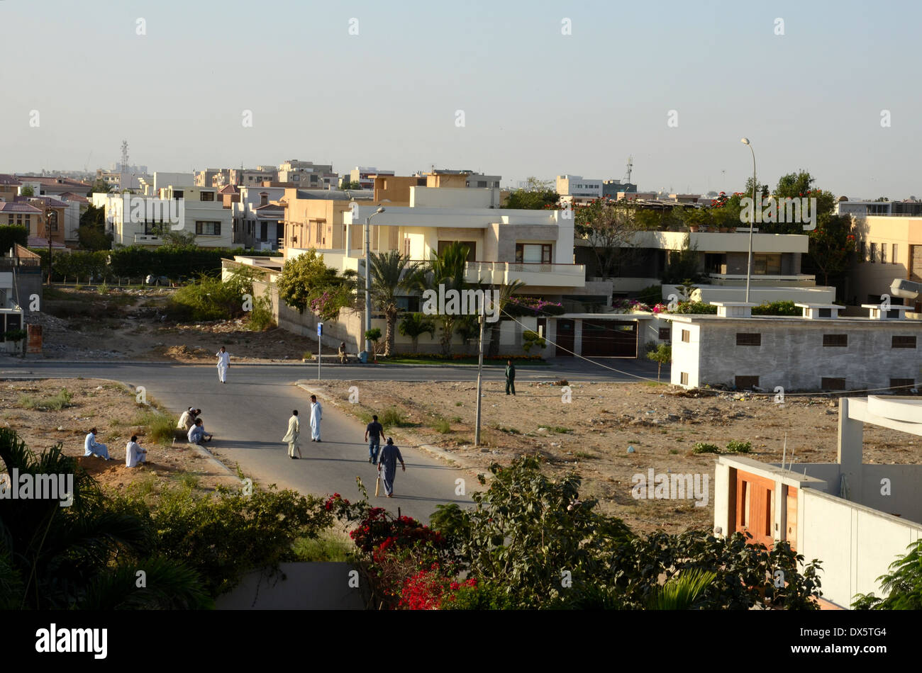 Pakistani Men In Traditional Salwar Kameez Play Street Cricket In Karachi Dha Suburb Pakistan