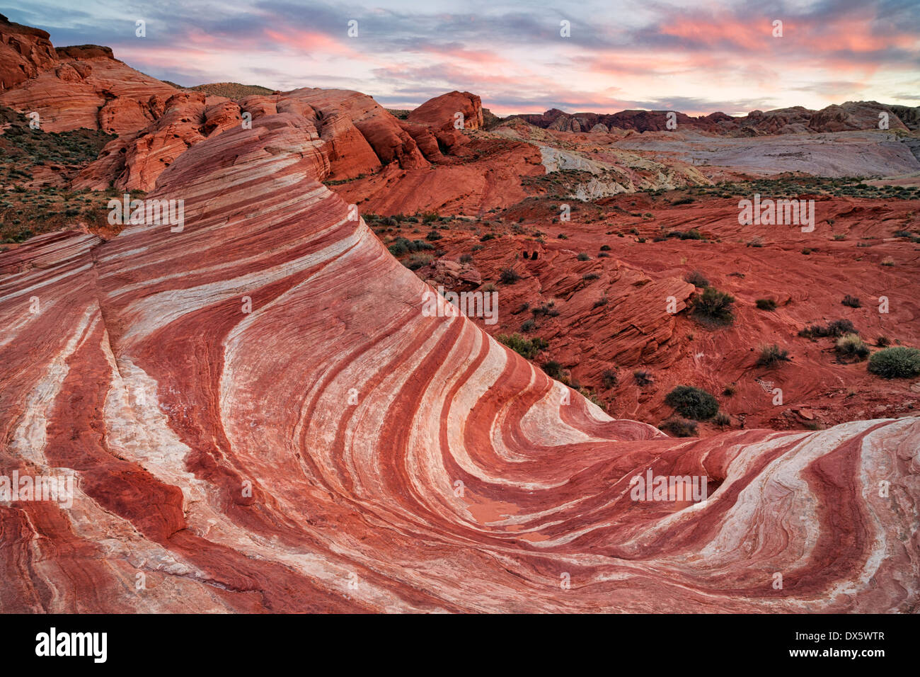 Sunset over the sandstone formation known as the Fire Wave in Nevada's Valley of Fire State Park. Stock Photo
