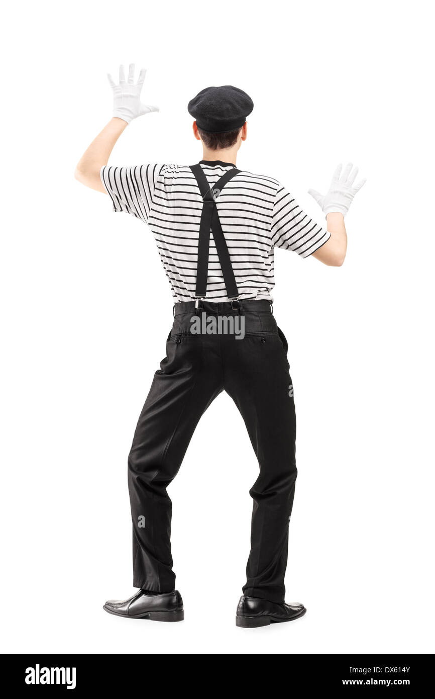 Full length portrait of a mime artist performing - Stock Image