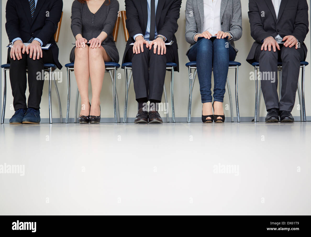 Cropped image of people in waiting - Stock Image