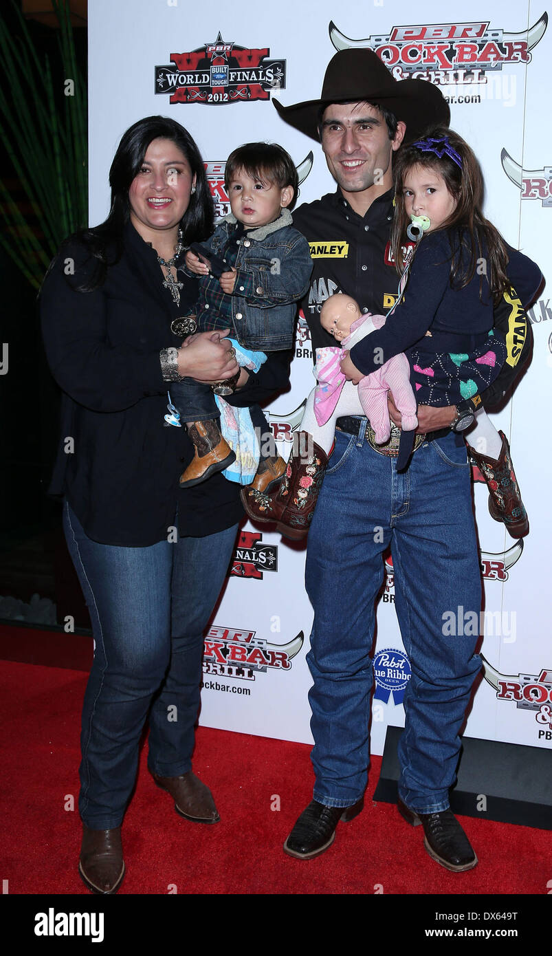 Silvano Alves and family Professional Bull Rider Superstars walk the red carpet at PBR Rock Bar inside The Miracle Mile Shops at Planet Hollywood Resort and Casino Las Vegas, Nevada - 26.10.12 Featuring: Silvano Alves and family Where: United States When: 26 Oct 2012 - Stock Image