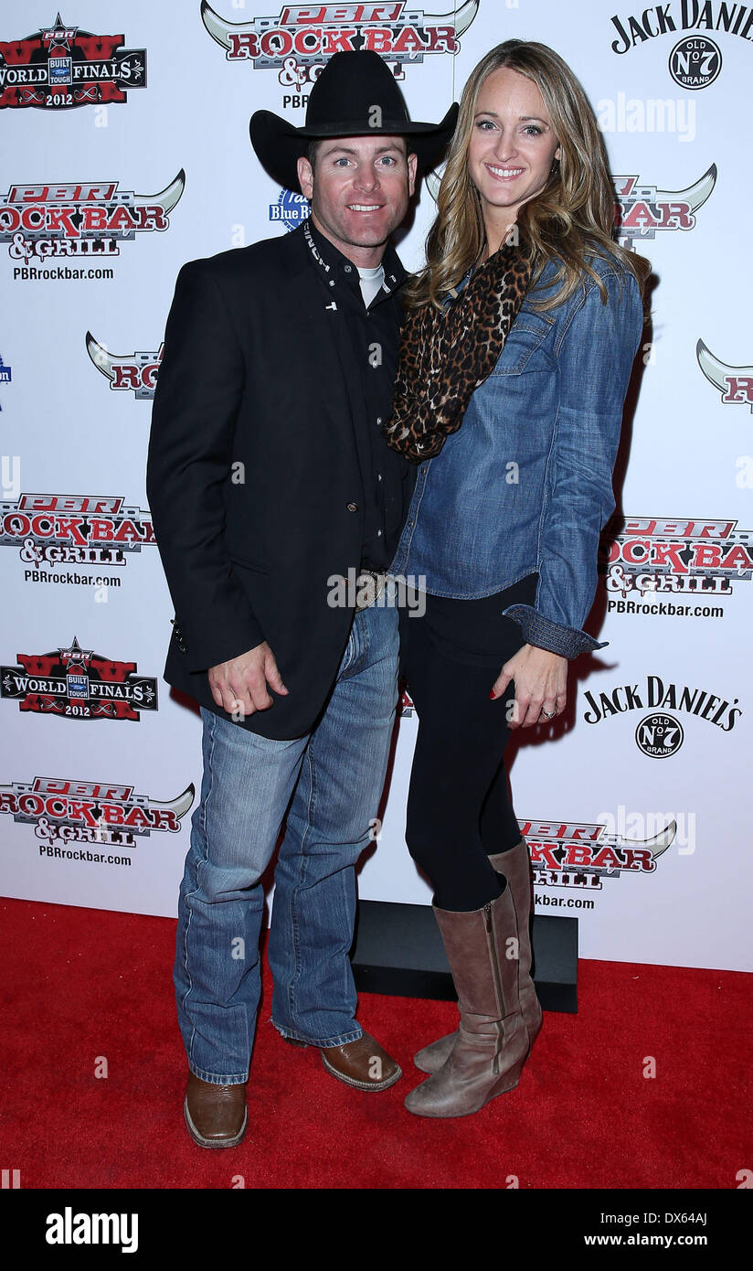 Brenden Clark and Guest Professional Bull Rider Superstars walk the red carpet at PBR Rock Bar inside The Miracle Mile Shops at Planet Hollywood Resort and Casino Las Vegas, Nevada - 26.10.12 Featuring: Brenden Clark and Guest Where: United States When: 26 Oct 2012 - Stock Image