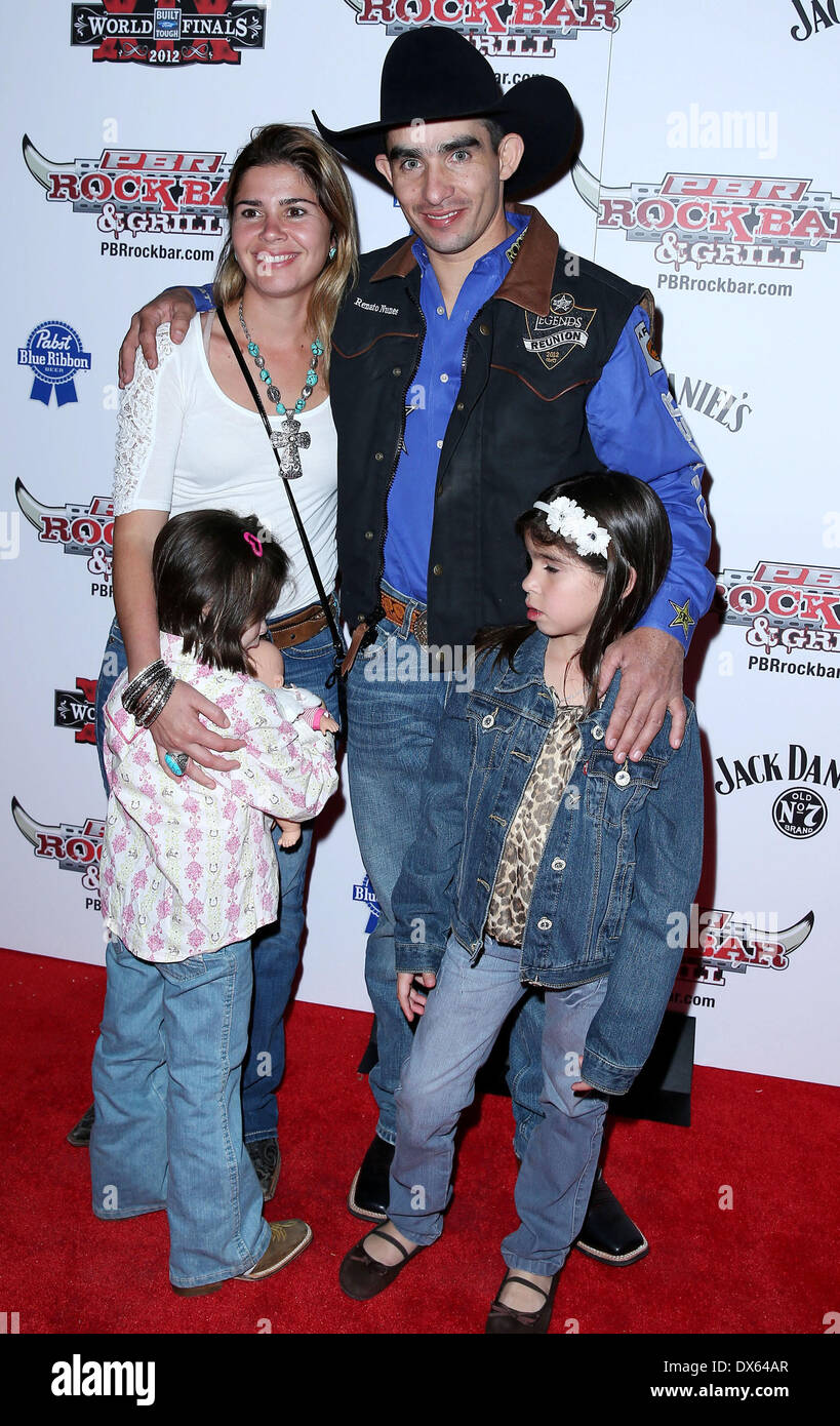 Renato Nunes and family Professional Bull Rider Superstars walk the red carpet at PBR Rock Bar inside The Miracle Mile Shops at Planet Hollywood Resort and Casino Las Vegas, Nevada - 26.10.12 Featuring: Renato Nunes and family Where: United States When: 26 Oct 2012 - Stock Image