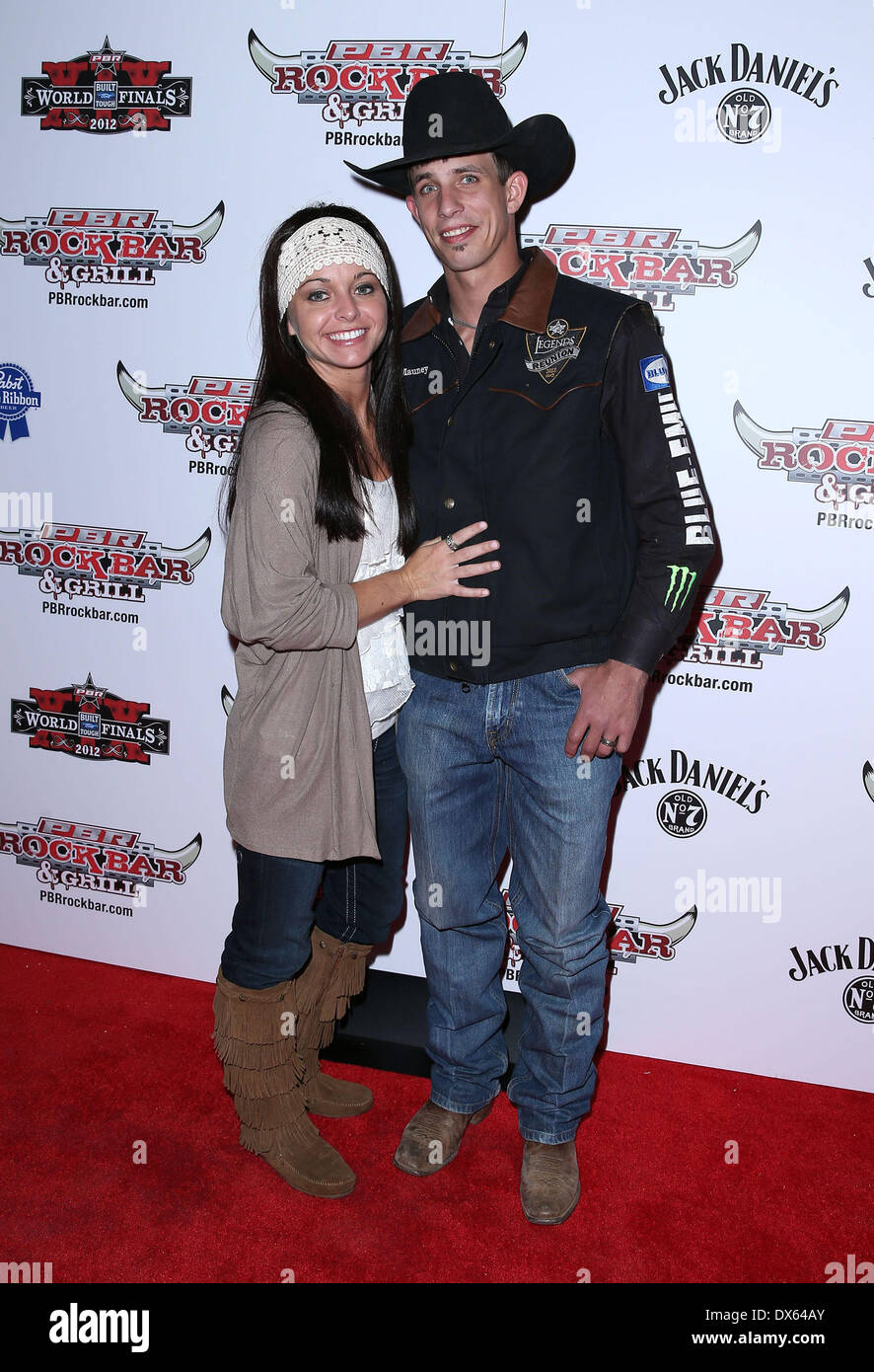 J B Mauney and Guest Professional Bull Rider Superstars walk the red carpet at PBR Rock Bar inside The Miracle Mile Shops at Planet Hollywood Resort and Casino Las Vegas, Nevada - 26.10.12 Featuring: J B Mauney and Guest Where: United States When: 26 Oct 2012 - Stock Image