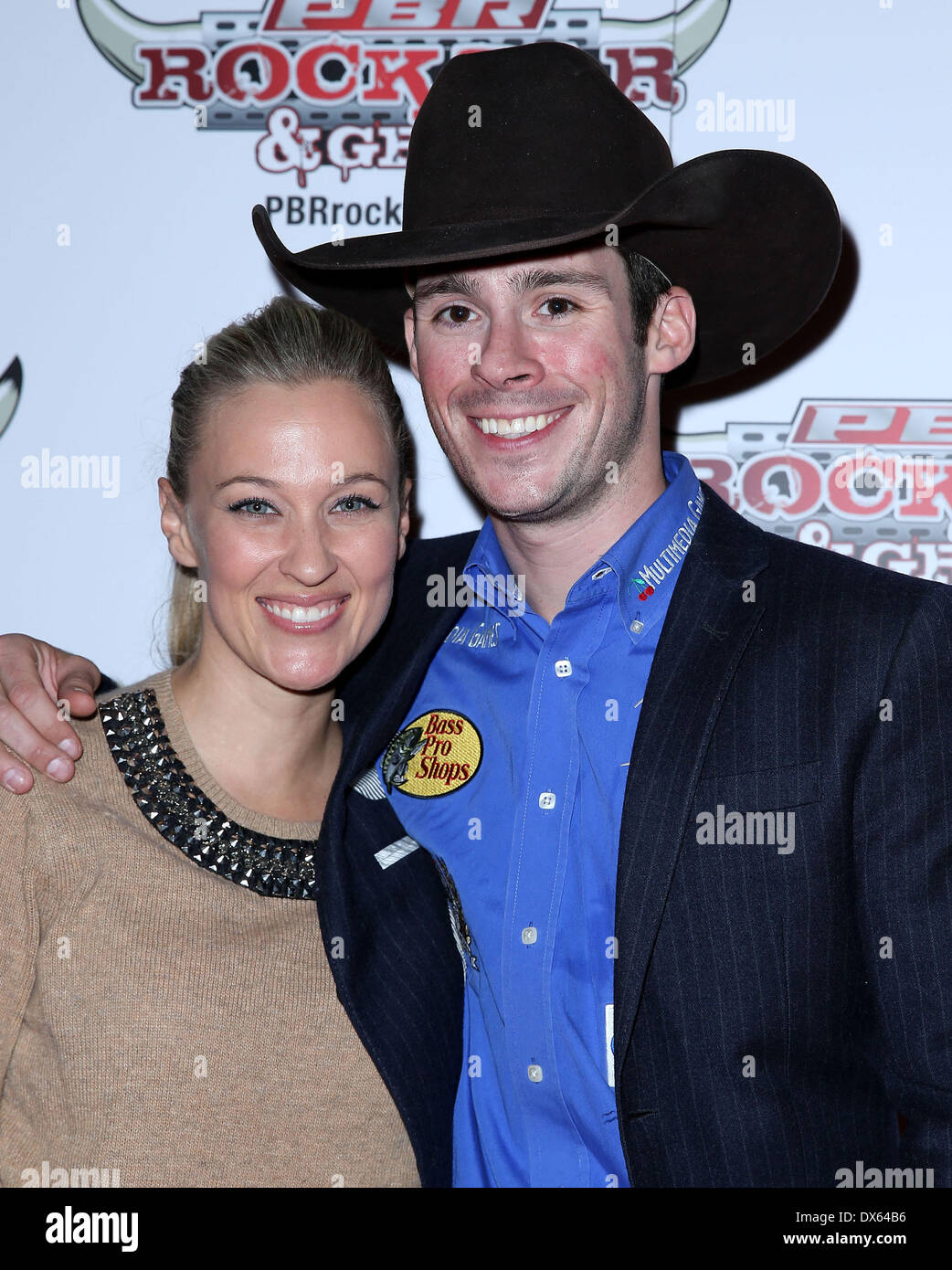 Jen Manna, Luke Snyder Professional Bull Rider Superstars walk the red carpet at PBR Rock Bar inside The Miracle Mile Shops at Planet Hollywood Resort and Casino Las Vegas, Nevada - 26.10.12 Featuring: Jen Manna, Luke Snyder Where: United States When: 26 Oct 2012 - Stock Image