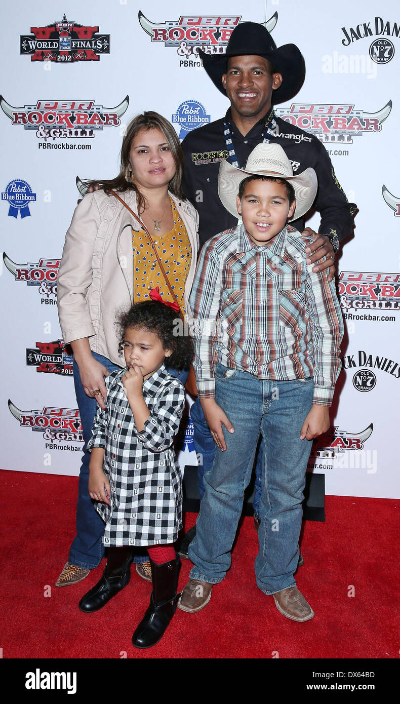 Valdiron de Oliveira and family Professional Bull Rider Superstars walk the red carpet at PBR Rock Bar inside The Miracle Mile Shops at Planet Hollywood Resort and Casino Las Vegas, Nevada - 26.10.12 Featuring: Valdiron de Oliveira and family Where: United States When: 26 Oct 2012 - Stock Image