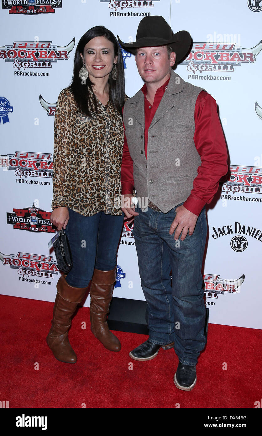 Chris Shivers and Guest Professional Bull Rider Superstars walk the red carpet at PBR Rock Bar inside The Miracle Mile Shops at Planet Hollywood Resort and Casino Las Vegas, Nevada - 26.10.12 Featuring: Chris Shivers and Guest Where: United States When: 26 Oct 2012 - Stock Image