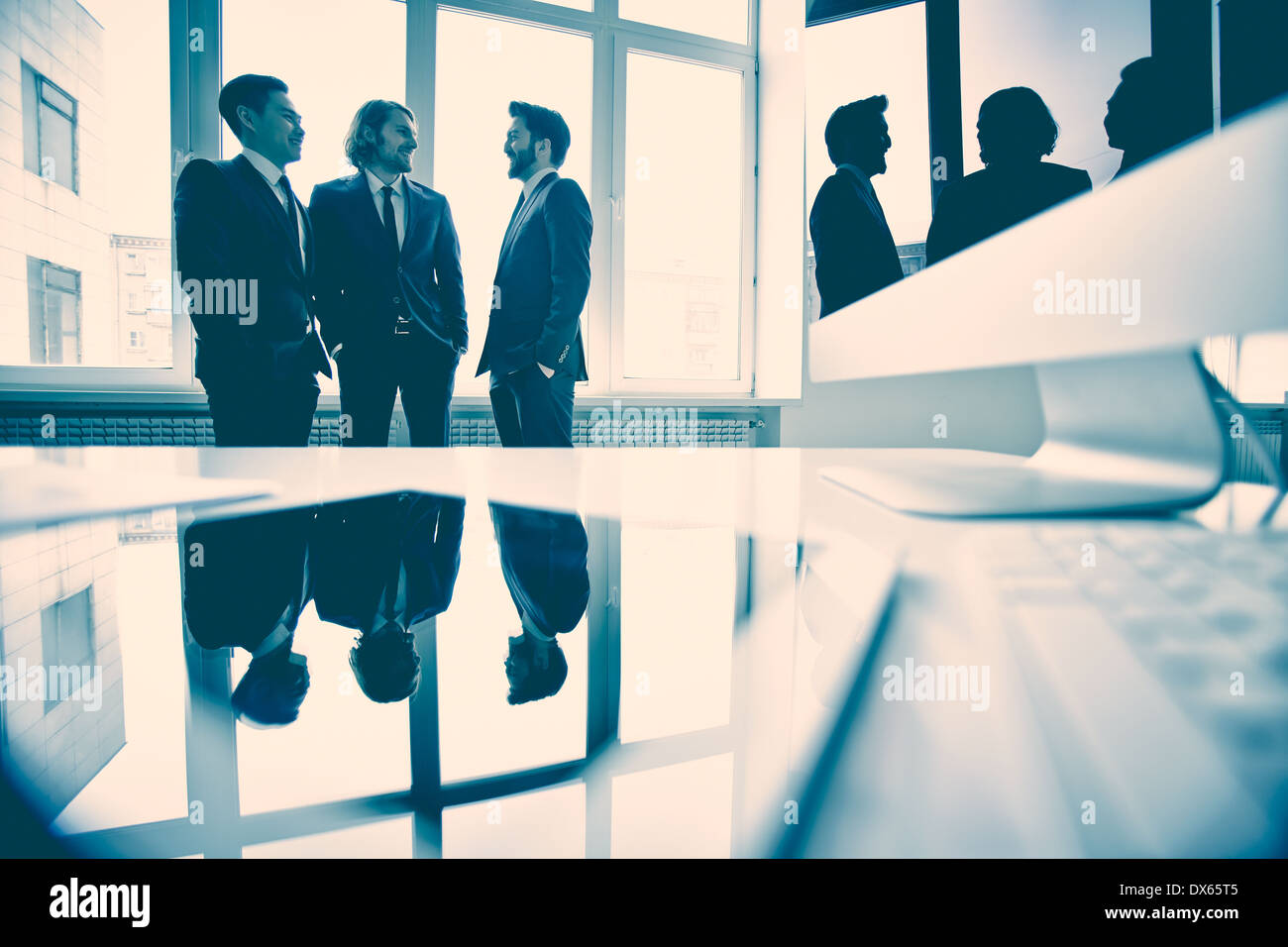 Business partners discussing new strategy in the meeting room - Stock Image