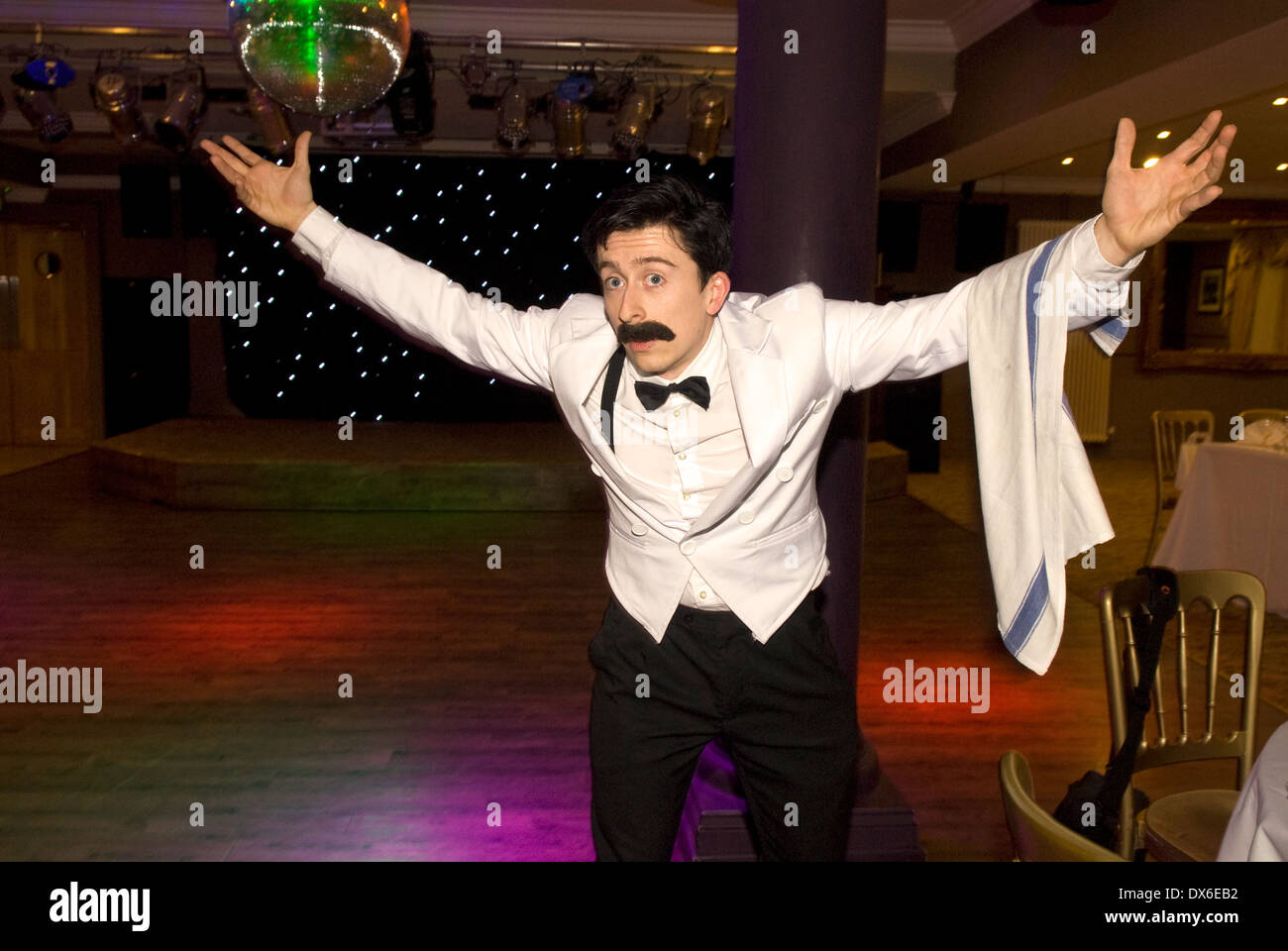 Tribute actor playing hapless waiter Manuel from Fawlty Towers, Liphook, Hampshire, UK. - Stock Image