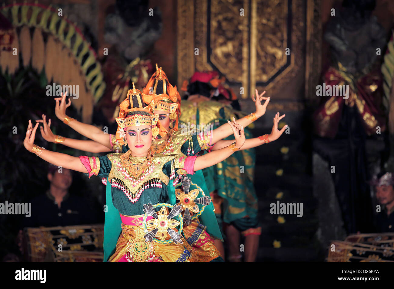 Balinese dancers on stage performing the Legong dance in Ubud, Bali - Stock Image