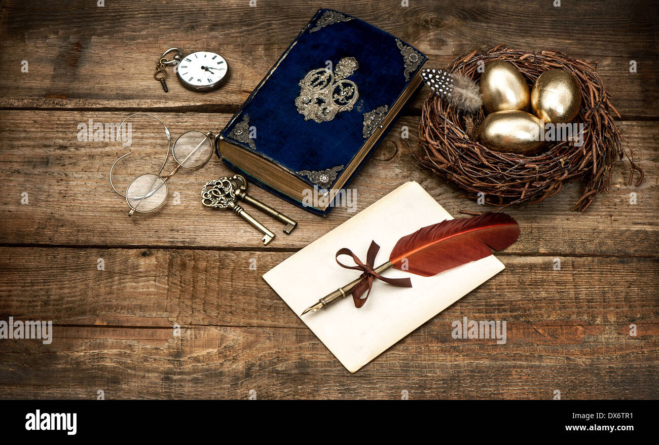 vintage easter still life composition. decoration with eggs and antique bible book Stock Photo