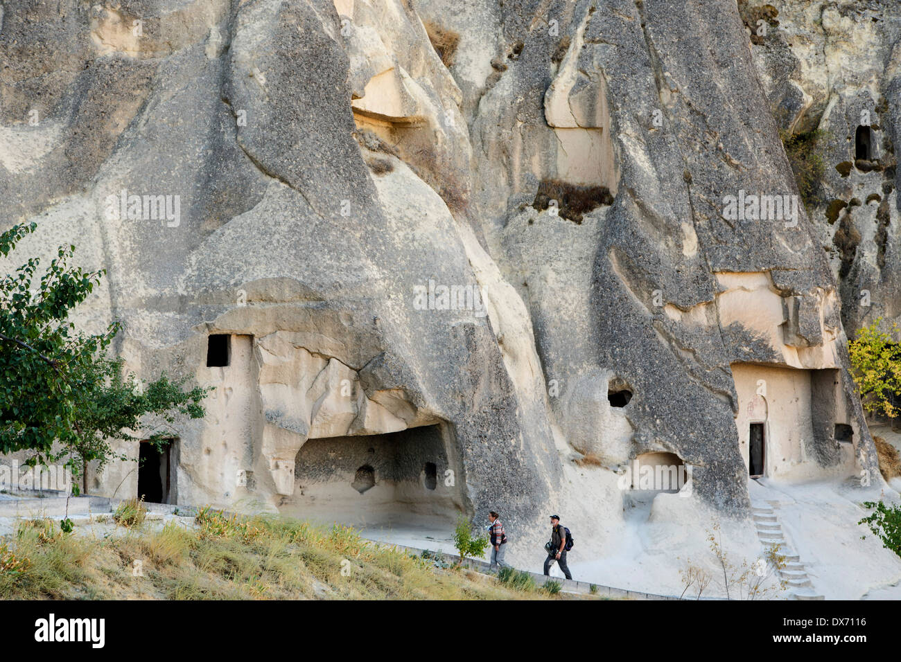 Visitors in front of portion of church complex, Goreme Open Air Museum, Goreme, Cappadocia, Turkey - Stock Image