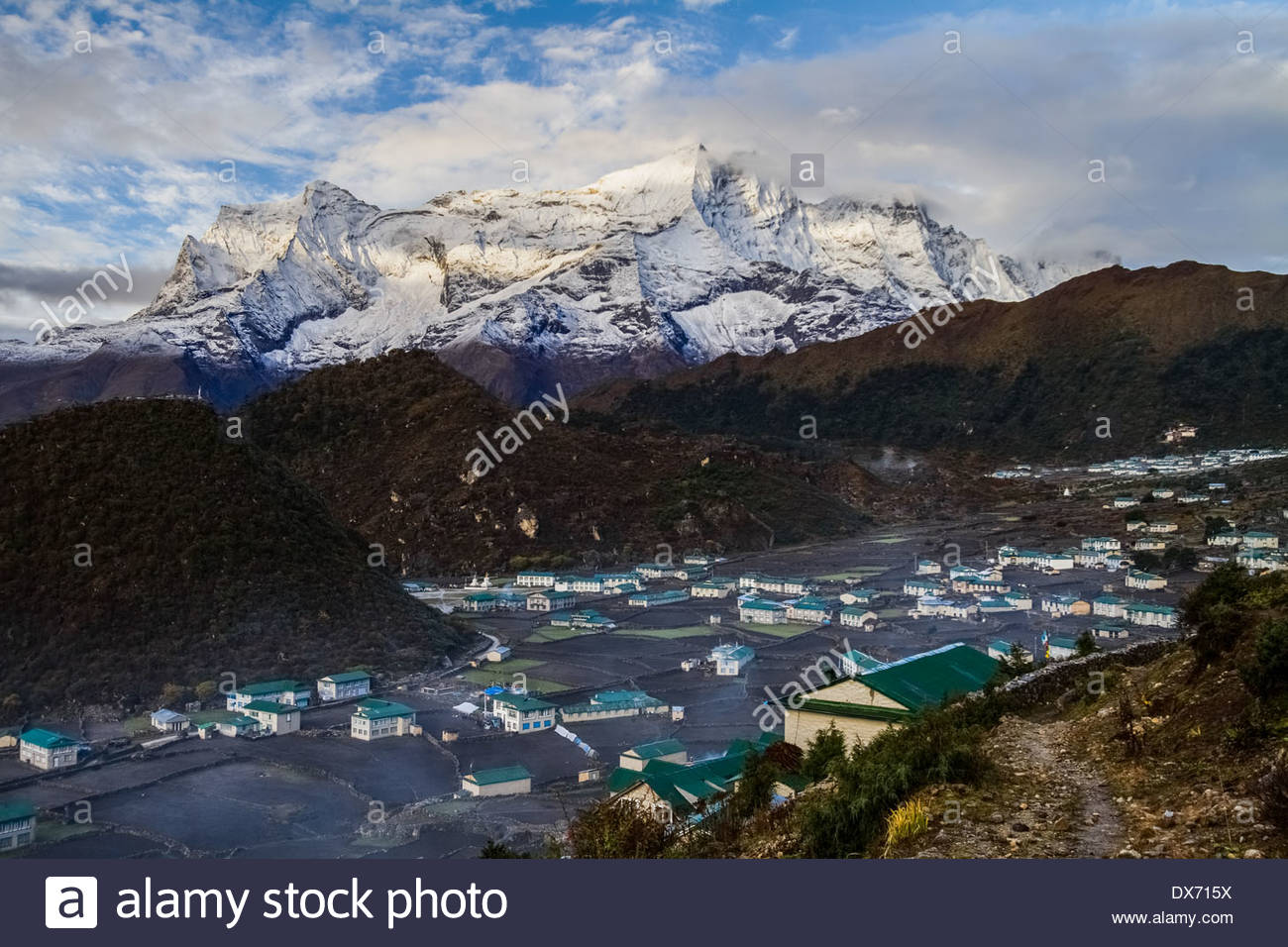 View of Khumjung village and snowcapped mountain - Nepal - Stock Image