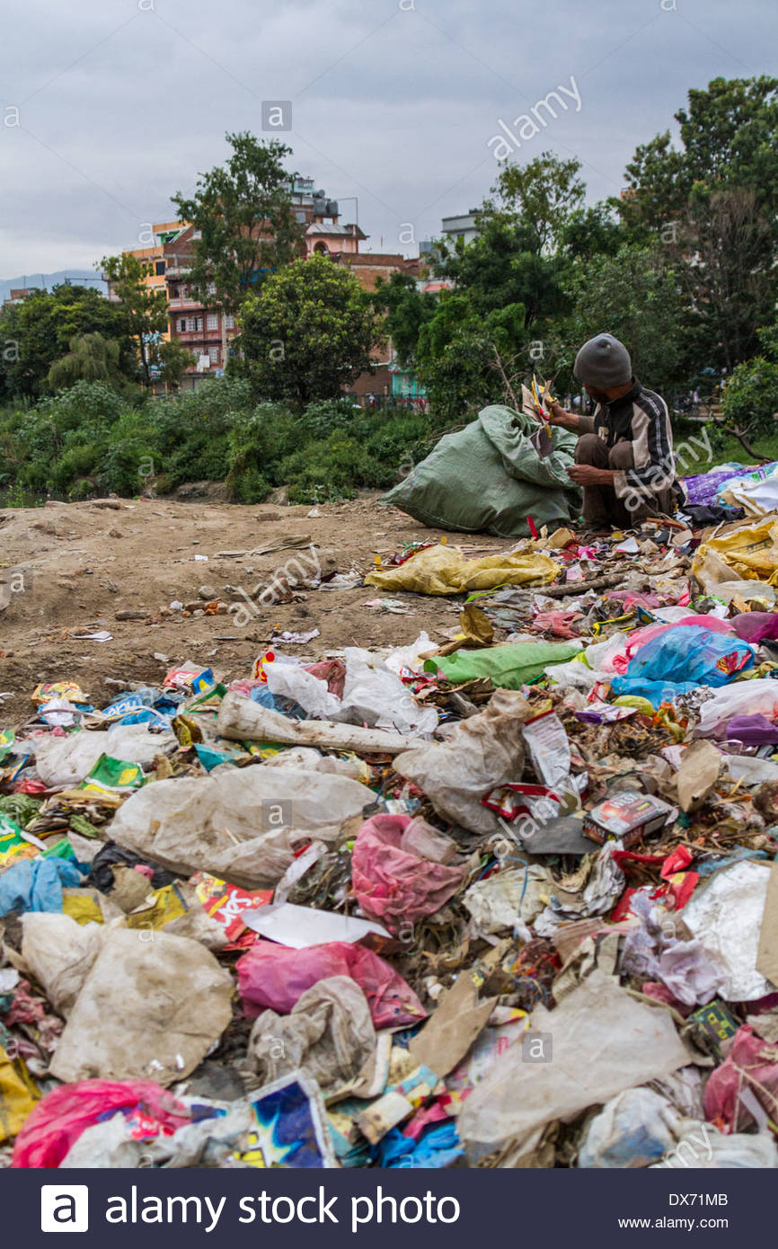 Scavenger searches for recyclable material at rubbish dump - Nepal - Stock Image