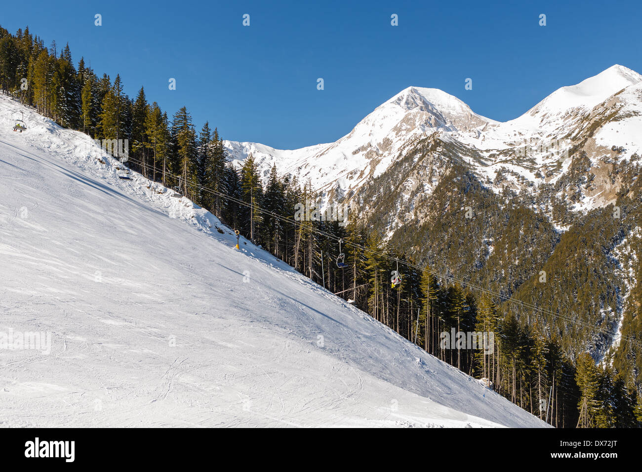 Mountain slope prepared for downhill skiing - Stock Image