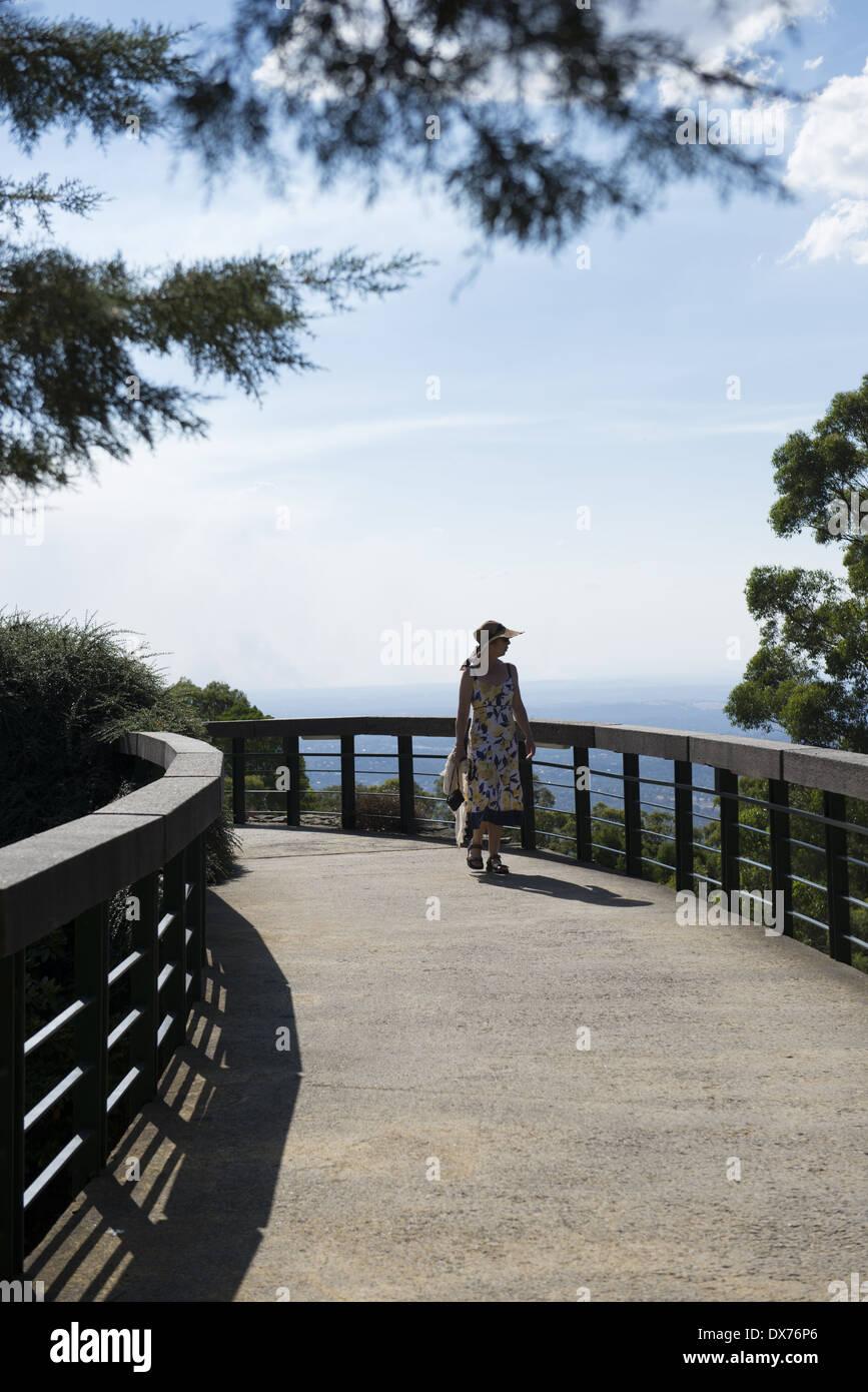 Skyhigh Mount Dandenong observatory. A lady walking along a path. - Stock Image